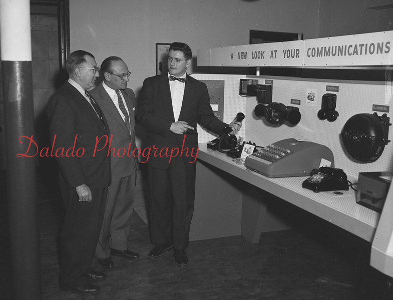 (Dec. 1955) Looking over modernistic equipment display at the Hotel Penn Lee by the Bell Telephone Co. are representatives of the local firm. Pointing out the improvements is John Rice, sales representative of the Bell Co., while looking on is Clifford Fox, manager of Kanmak Mills, Kulpmont, and C.F. Miller, center, manager of the local Bell officer.