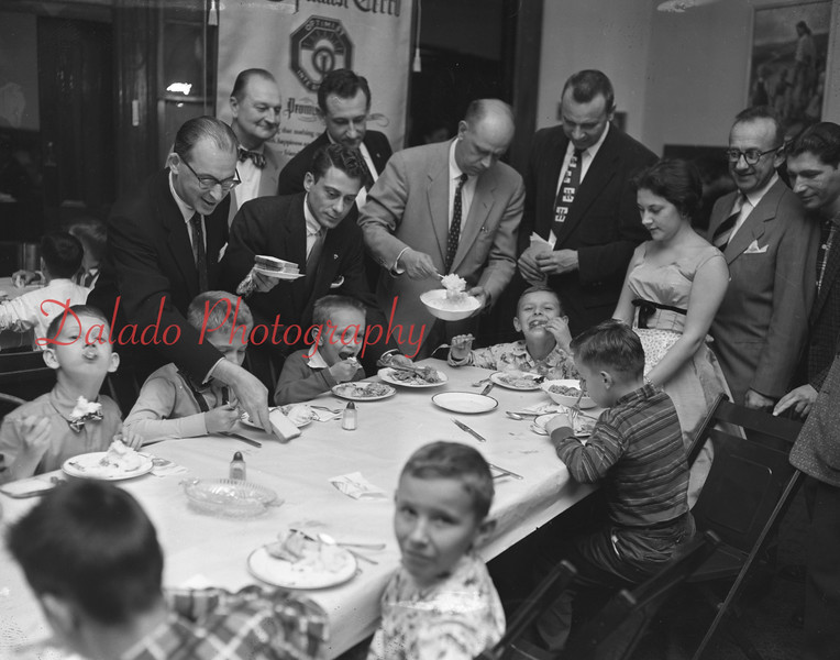 (11.08.56) Group of 150 youngsters are treated to a turkey dinner by the Optimist Club at St. John's Reformed Church. Pictured are, from left, Ben Yashan, William McCall, George Bernstein, Eugene Day, Richard Davis, Edward Bruskey, Joel Freidman and Bernard Winnick.