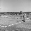 (1956) Bill Ondo, proprietor of Andy's Produce, looks at grounds for a new building. The former building burned down on July 2, when lightning struck the wire over the warehouse near the viaduct. He soon bought a plot of land on the west side of Willow Street at Sixth Street from Reading Coal Co. Building will be 65-by-75 feet.