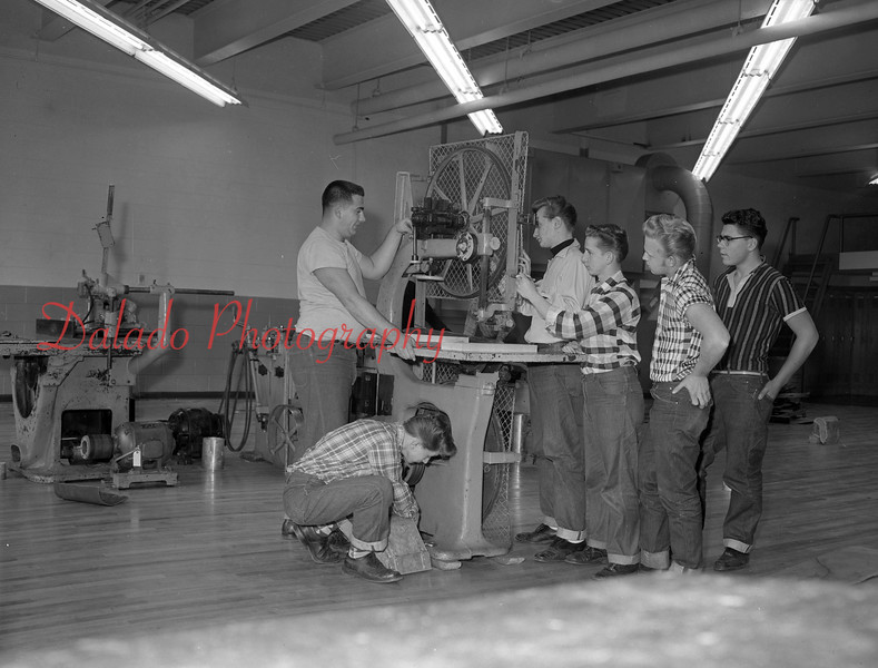 (11.22.56) Vo-Tech students installing a new saw.