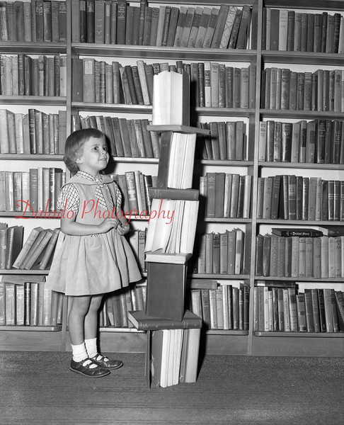 (09.27.56) Kathy Magaskie, 127 E. Spurzheim St., looks over the stacks of books at the Shamokin-Coal Township Public Library.