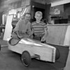 (July 1956) Daniel Bradigan, 239 W. Pine St., puts the final touches on his racer for the Shamokin Soap Box Derby slated for July 11. Under the guiding eye of Ed Shawda.