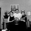 (November 1956) That gold-painted Coal Bucket that cheerleaders Eleanor Moratelli, left, and Joan Karlow are holding will be the prize for the big game between Mount Carmel and Shamokin. Dan Ficca, captain of the Red Tornadoes, is the man who may keep it on the Mount Carmel shelf.