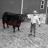 (Jan. 1956) Proudly displaying the black Angus steer which he will enter as a 4-H Club member at the state Farm Show is Jay Leisenring of Bear Gap.