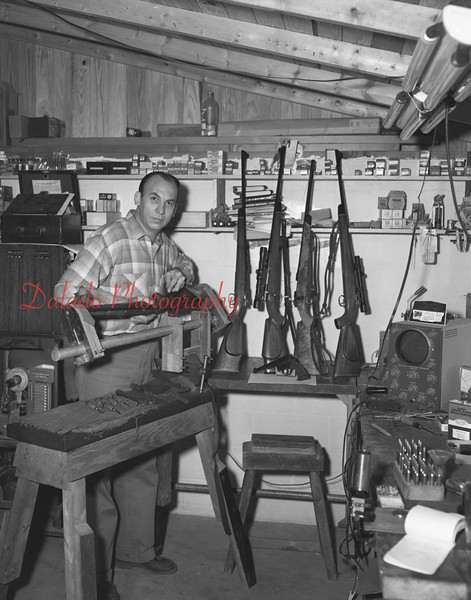 """(Feb. 1956) Leon """"Lindy"""" Lunderman, who fashions stocks for guns. He had been engaged in this hobby for the past five years."""