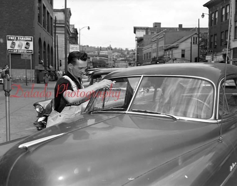 (Oct. 1956) Car washing.