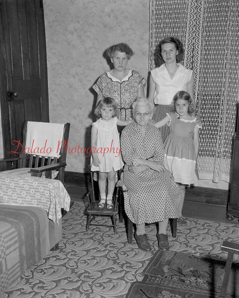(05.26.55) Four generations of Mary Ellen Swank family. Shown are great granddaughters Barbara and Melanie Betz, standing are granddaughter George Betz and sister Clarence Yocum.