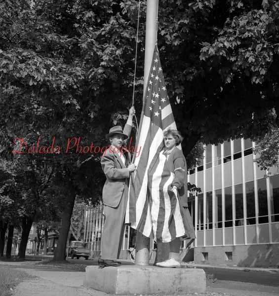 (1956) Raising flag along Lincoln Street.