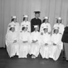 (05.16.57) Supt. Victor Peek sits with five sets of twins that are among the graduating class. Pictured are, from left, Ellen and Elinor Taylor, Joan and Pat Cain, Elaine and Eric Griffiths, Joan and jean Darstein and Martha and Mary Kaminski.