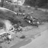 (May 1957) East End Fire Co. taking part in a drill along Bennys Run.