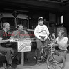 Looks to be a bicycle safety awareness program at the Independence Fire Co. Rev. Souders is pictured at left.