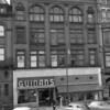 (1954) Zimmerman Building- This building, at 33 E. Independence St., along with the top portion of the building on the left, burned in a spectacular fire on Dec. 31, 1974. At the time of the fire Leavett's Furniture Company occupied the first floor. The building was torn down days after the fire, and the plot of land sold on Aug. 14, 1978, for $100,000 to the Wendy's Corp.