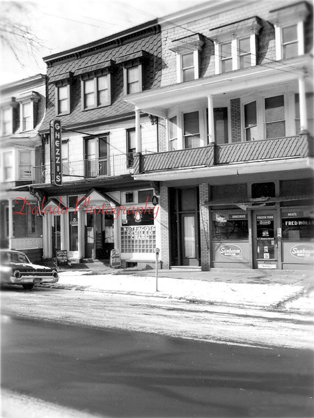 Ghezzi's and Fred Holler's- These businesses were located next to the present day Lucas Funeral Home on Market Street.