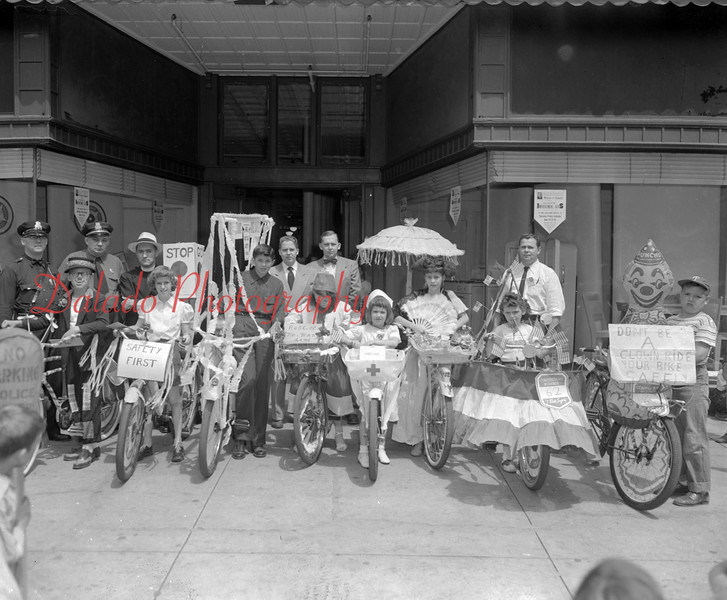 (June 1951) Most likely a bicycle showcase in front of Montgomery Ward.