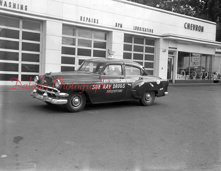 (09.19.1961) Sun Ray Drugs car at a Chevron Station.