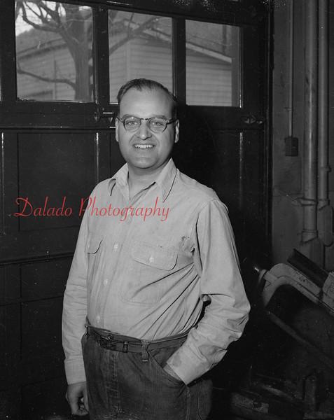 (05.10.53) Norman Hubler, a barber, at 127 Franklin St.