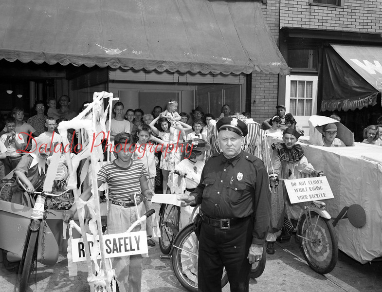 (1951) Homemade bicycles in front of Montgomery Ward along Market Street in Shamokin.