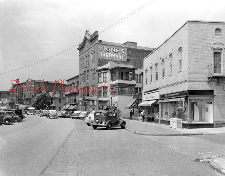 (05.23.1941) One block up at Independence and Ninth streets. Jones  Hardware and The Capital Threatre is seen in the distance.