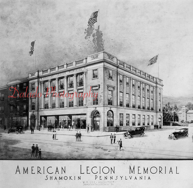 Artist's illustration (minus the marks near the flag pole) of the new American Legion Building- ...The first library was established in a vacant room on the first floor of the Shamokin High School, Eighth and Arch streets, in fall 1923. The school board set aside money in the spring to be used for a library for both students and the public. The Shamokin class of 1923 also set aside $100 for the library. The first library in its own home opened Sept. 20, 1953, at 508 N. Eighth St. The E.R. Leader Building at 69 E. Independence St. (Laundromat) was purchased with the help of a $18,000 donation by John Gillespie. The library was dedicated Sept. 25, 1963. On Nov. 22, 1966, work for the new library started began where Wolfe's department store was located. It was dedicated on June 24, 1967. John. S. Luckens, a local architect, designed the structure. $167,000 in federal grants and $43,000 in local funds were used to build the library. The city leased the building from the American Legion, through the War Memorial Corporation board, for 99 years for $1. The lease was renegotiated in 2013.