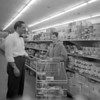 (1958) Paul Schell, manager of Acme in Shamokin, talks to a customer.