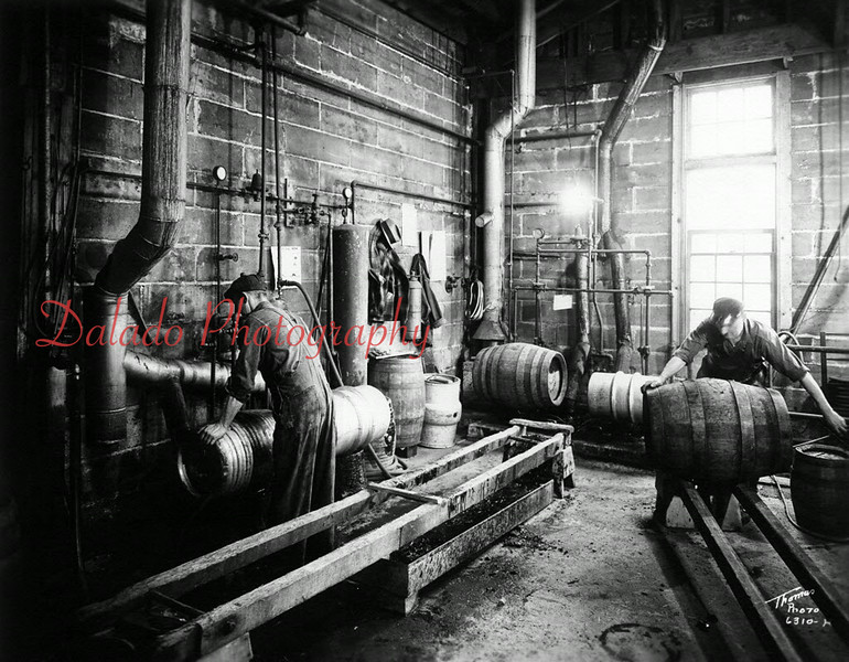 Two men are busy making kegs at the former F&S Brewery in Shamokin.