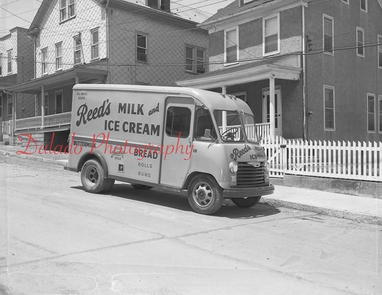 (1955) Reed's trucks.