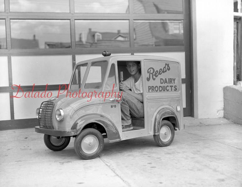 (July 1957) Reed's miniature car.