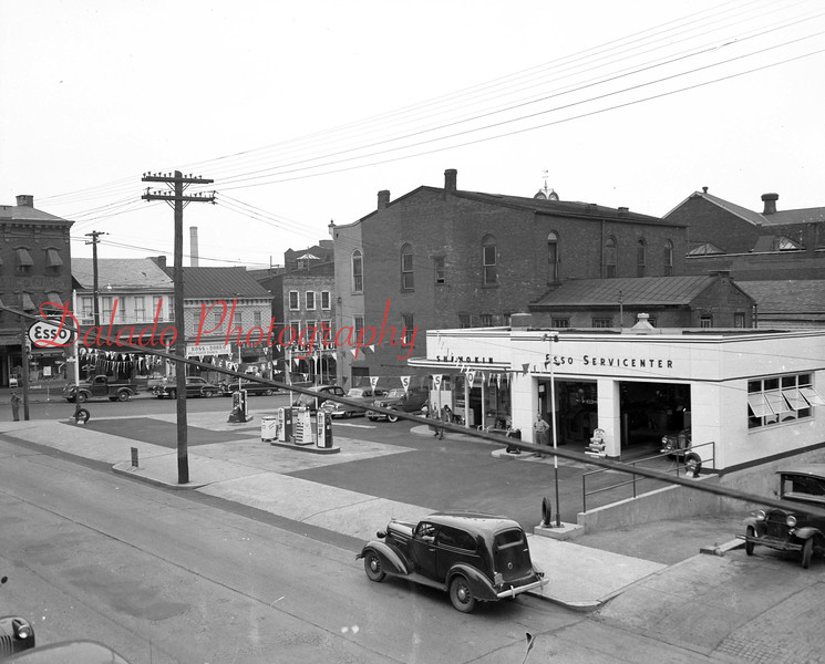 (1949)  Roman Blusius' Esso Station- Now the location of Exxon on Sunbury Street. (The two buildings in the background, at right, were torn down in June of 2012. The middle buildings caught fire in September later that year.)
