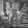 (Sept. 1962) Top man in the Wilkes-Barre District Atlas Bucron tire contest is Roman Blusius, at left, the owner of the Shamokin Esso Service Station. Blusius will receive a movie camera from the company. He got a helping hand in the contest from his assistant, R. Paul Peifer.