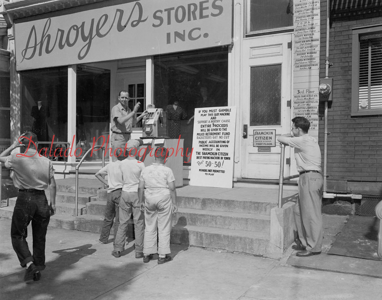 (1951) Slot machine at the Shamokin Citizen office. Funds went to the police retirement fund.