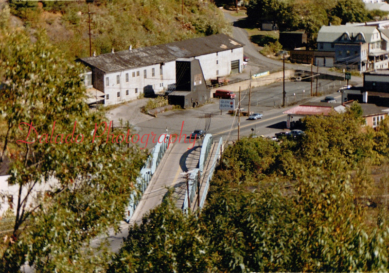 (10.04.1987) While the first thing you tend to look at in this photo is the Cameron Bridge and the Pump House, don't forget to look at the old gas station building where Jack Williams Tire and Auto is now. All three structures are gone.