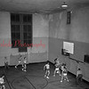 (10.09.1953) Basketball game in unknown gym.