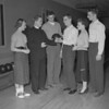 (1955) A priest and a bowling team.