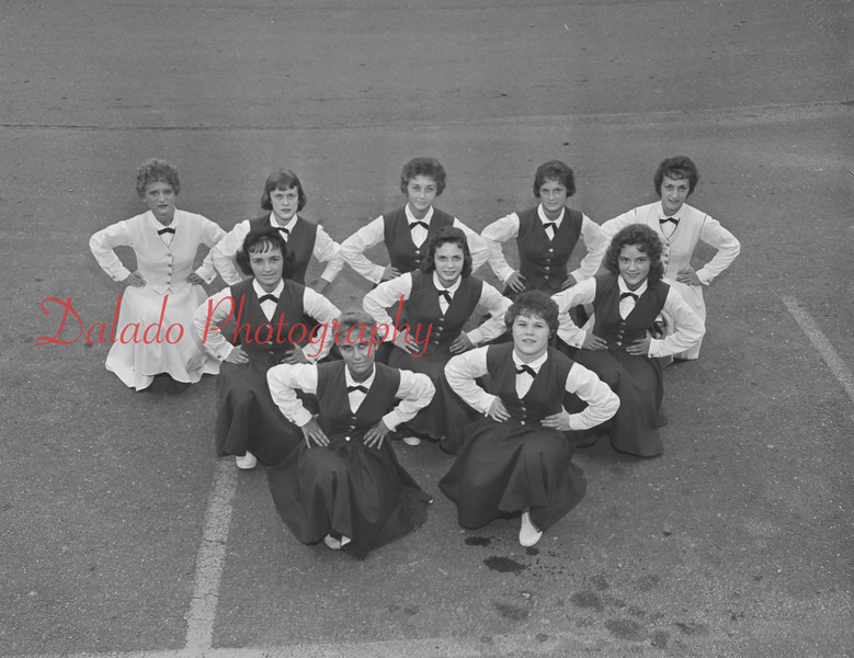 (1959) Cheerleaders are, front row, front left, Joyce Olesnevich and Sandy Persing; middle, Barbara Hasuga, Marie Dombroski and Anna Marie Seroski; third, Judy Royack, Kris Michaels, Fern Davis, Germaine Wargo and Janet Neary.