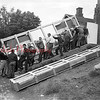 (1955) Coal Township High School football players help move a new scoreboard.