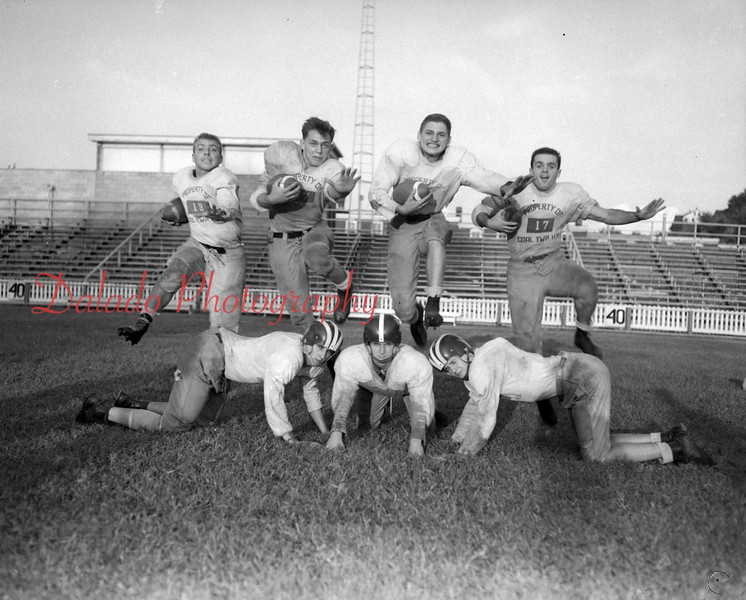 (09.13.53) Coal Township football players are Bernie Rumberger, Joe Sabol, Mike Estock and Billy Shaffer; kneeling, Francis Gotaski, Joe Seasock and Mike Shebelsky.
