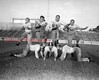 (09.13.53) Coal Township football players are Bernie Rumberger, Joe Sabol, Mike Estock and Billy Shaffer; kneeling, Francis Gotaski, Joe Seasock and Mike Shebelsky.