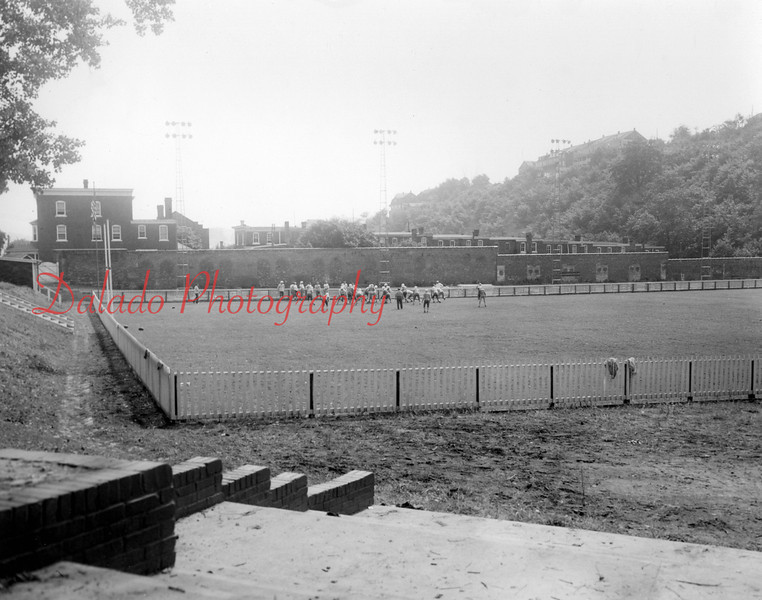 Another shot of the stadium. The brick wall was made from bricks from the J.H. & C.K. Eagle Silk Mill after the buildings were demolished. The stadium was built around 1948. A majority of the wall still stands today.