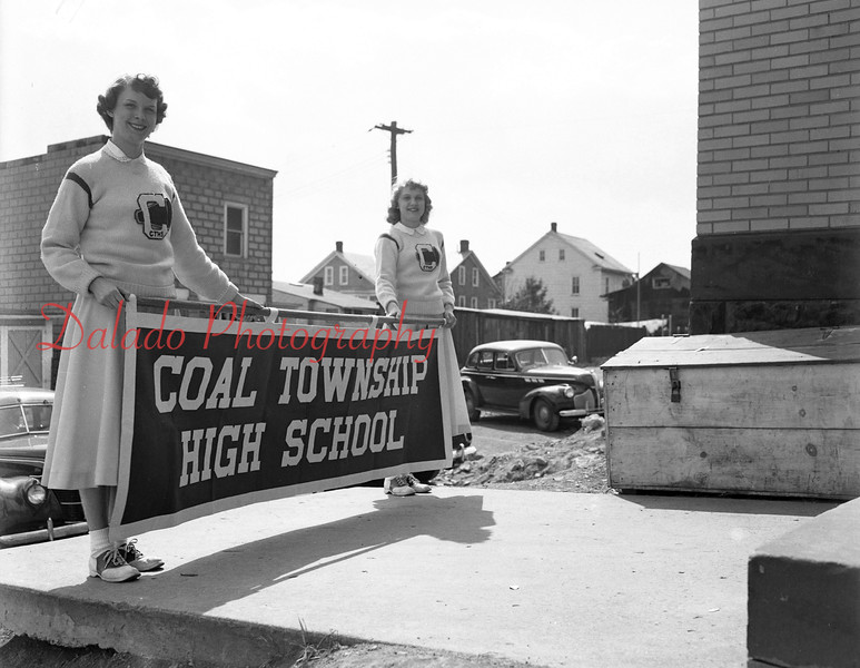 (04.03.1952) Cheerleaders with a new Coal Township High School banner.