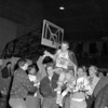 (03.21.57) Held high on the shoulders of his classmates is Jim Zimmerman, center for Coal Township, who scored 19 points for the 71-51 victory over Nanticoke.