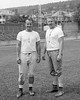 """(09.19.1957) Shown in the Coal Township High School football stadium are Joe """"Jazz"""" Diminick, left, and Bernie Romanoski Sr. Jazz was coach of the Purple Demons in 1956 and 1957."""