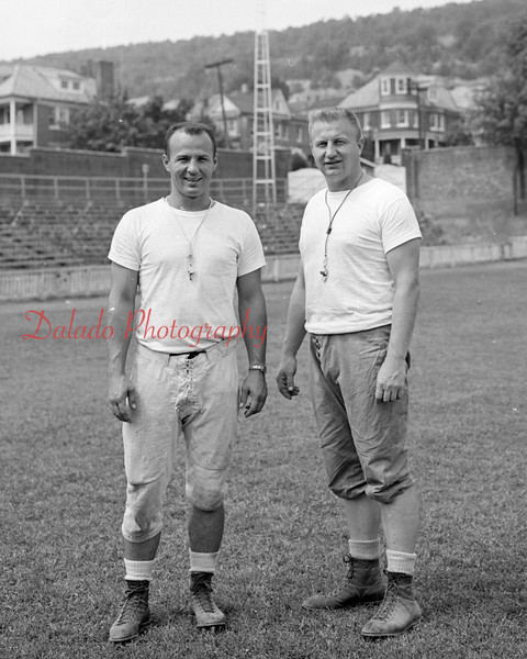"(09.19.1957) Shown in the Coal Township High School football stadium are Joe ""Jazz"" Diminick, left, and Bernie Romanoski Sr. Jazz was coach of the Purple Demons in 1956 and 1957."
