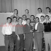 (03.10.55) CTHS basketball, presentation of a trophy in recognition of Coal Township's victory over Sunbury in the District IV finals played at Bucknell University. Pictured are, front row, from left, Carl Olley, Joe Dimminick, George Conbier, principal; John Timco and Pat Madden; second, Ray Luberecki, Mike Neary, Gene Lauer and Gary Sheriff; third, Bobby Naike, Vince Paczkowski, Walt Gubernot and Al Sobol.