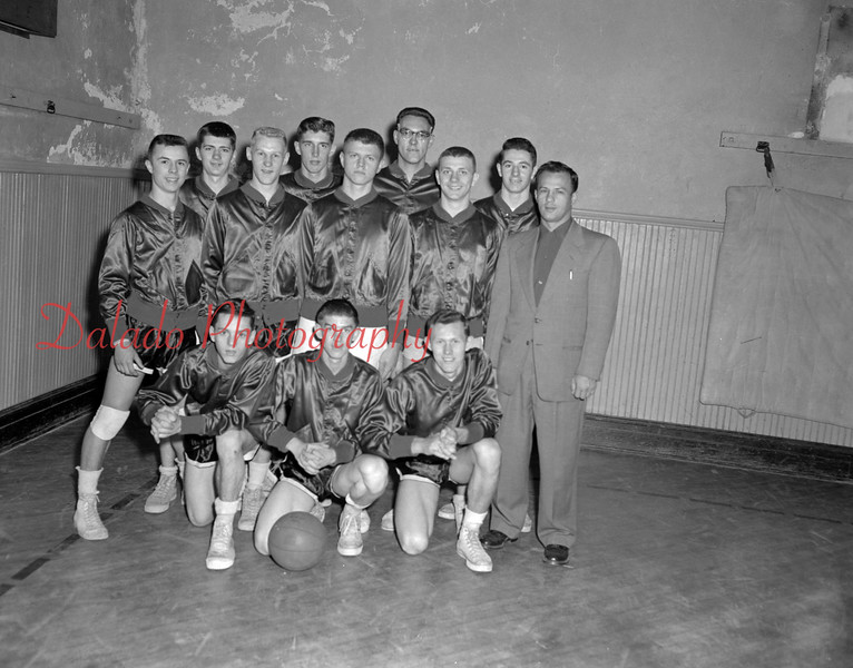 "(12.02.54) Coal Township High School basketball are, front row, ""Gunner"" Timco, Carl Olley and Ray Luberecki; second, Bobby Narke, Walt Gubernot, Billy Paczkowski, Al Sabol and Coach Joe Diminick; third, Gary Sheriff, J. Hartman, Gene Lauer and Mike Neary."