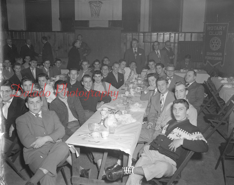 (01.18.51) Coal Township High School football team with coaches. Walter Marshall, Roy Sanders, Ed Sutt and trainers Bernie Romanoski and Tony Mosella were honored at a testimonial dinner sponsored by the Rotary Club served at the First Presbyterian Church.