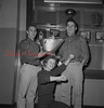 (11.28.1957) The Coal Bucket is at stake in the Thanksgiving Day football classic when the Mount Carmel Red Torndaoes meet the Greyhounds at Kemp Memorial Stadium. Jerry Haupt, left, and Jess Snyder display the trophy while Barbara Edwards, co-captain of the cheerleaders, strike a typical pose on Nov. 28, 1957.