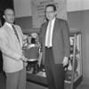 (Nov. 1962) Coach Joe Diminick presenting the Coal Bucket to Principal Vincent McHail following the Red Tornadoes win over Shamokin.