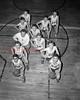 (01.18.53) Kulpmont basetball team are, lower left to right, D. Feudale, Ed Wasacavage, Ed Stavinski (coach), Stan Chesney and Stan Daniels; bottom right, M. Gard, Jerome Marshalek, Ed Yablonski, Joe Witowski, Joe Gencavage and Frank Ziegler.