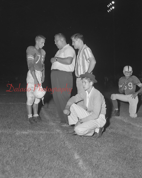 (1959) Kulpmont Wildcat coach Edward Stavenski talks to quarterback Wayne Whitney during a loss to Ashland. Also in on the conversation is Tony Toter.