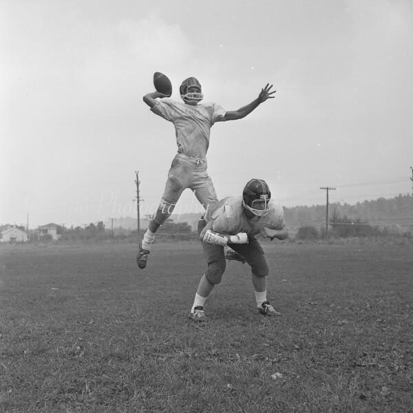 (1963) Mount Carmel Catholic High School 1963 season. Shown is center Frank Bach and quarterback John Davis.